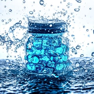 Warming a cooling gels image of a glass jar filled with bright pale blue gel balls and surrounded by splashing water