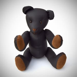 Kinky Teddy Bear made from Sheets of San Francisco Black fluidproof fabric. Seated position with brown paws.