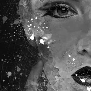 A messy imagoes part of a woman face showing one eye and part nose and lips in grey shades and blacks